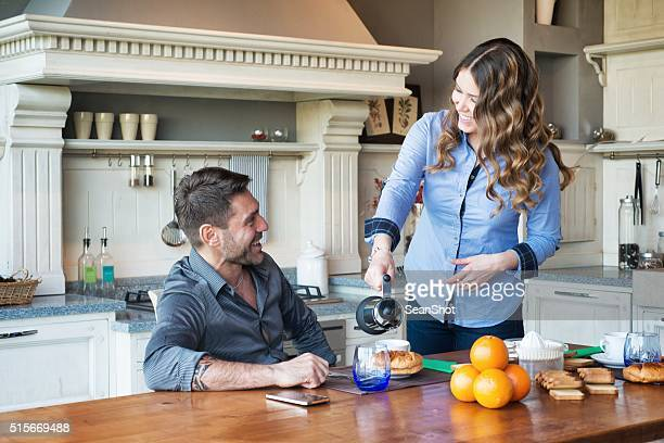 Time to Breakfast. Smiling Couple in Kitchen