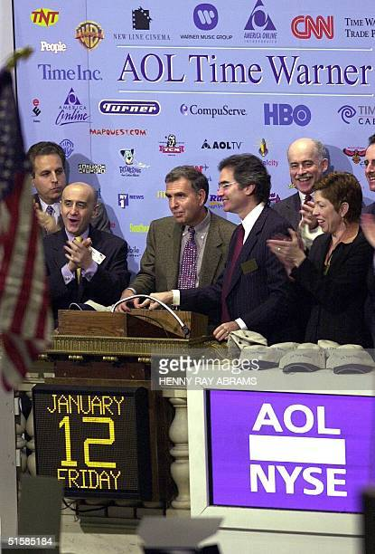 Time Warner CEO Gerald Levin and AOL Time Warner coCEO Robert Pittman ring the opening bell at the New York Stock Exchange to celebrate the merger of...