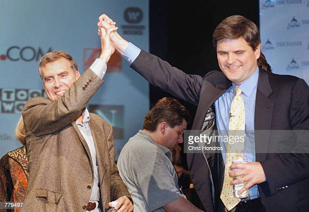 Time Warner Chairman and CEO Gerald Levin left and America Online Chairman and CEO Steve Case give a high five January 10 2000 in New York City after...
