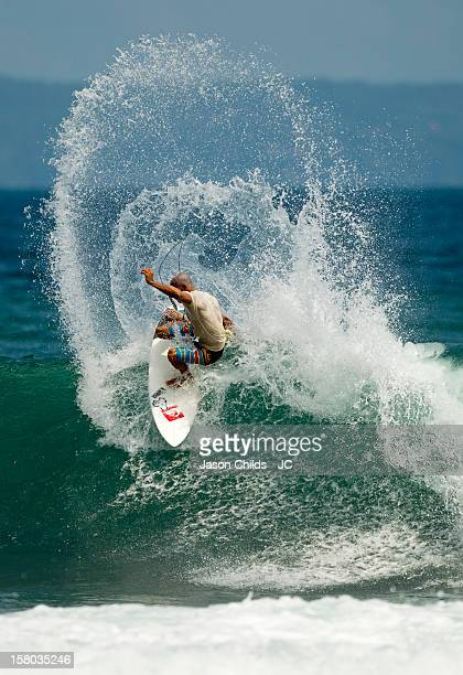11 time World Surfing Champion Kelly Slater surfs at Canggu Beach on April 23 2012 in Kuta Indonesia