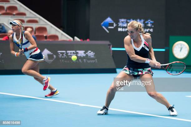 Timea Babos of Hungary and Andrea Hlavackova of Czech Republic return a shot during the Women's doubles semifinals match against Ekateria Makarova of...