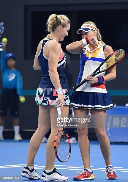 Timea Babos of Hungary and Andrea Hlavackova of Czech Republic talk during their Women's doubles final match against YungJan Chan of Chinese Taipei...