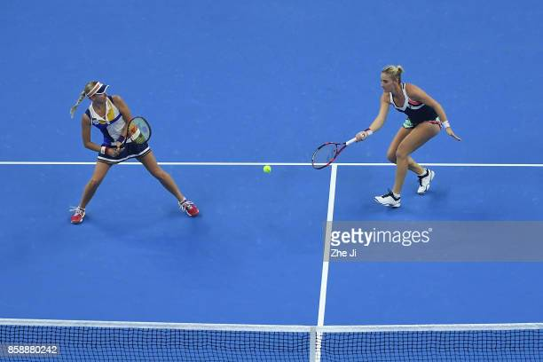 Timea Babos of Hungary and Andrea Hlavackova of the Czech Republic return a shot against YungJan Chan of Chinese Taipei and Martina Hingis of...