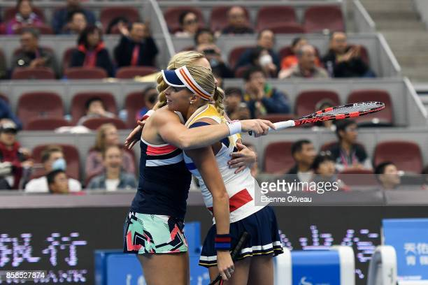 Timea Babos of Hungary and Andrea Hlavackova of the Czech Republic celebrate their victory over Ekaterina Makarova and Elena Vesnina of Russia during...