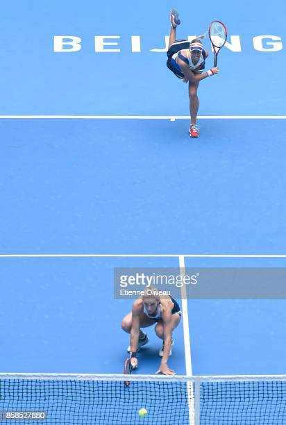 Timea Babos of Hungary and Andrea Hlavackova of the Czech Republic serve against Ekaterina Makarova and Elena Vesnina of Russia during their WomenÕs...