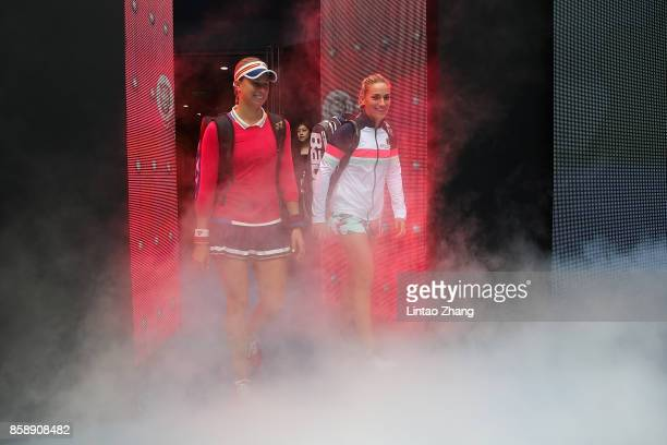 BEIJING CHINA OCTOBER Timea Babos of Hungary and Andrea Hlavackova of the Czech Republic enters the tennis court during the Women's doubles final...