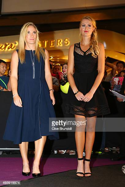 Timea Babos of Hungary and Kristina Mladenovic of Switzerland attend the Official Draw Ceremony prior to the BNP Paribas WTA Finals at The Shoppes at...