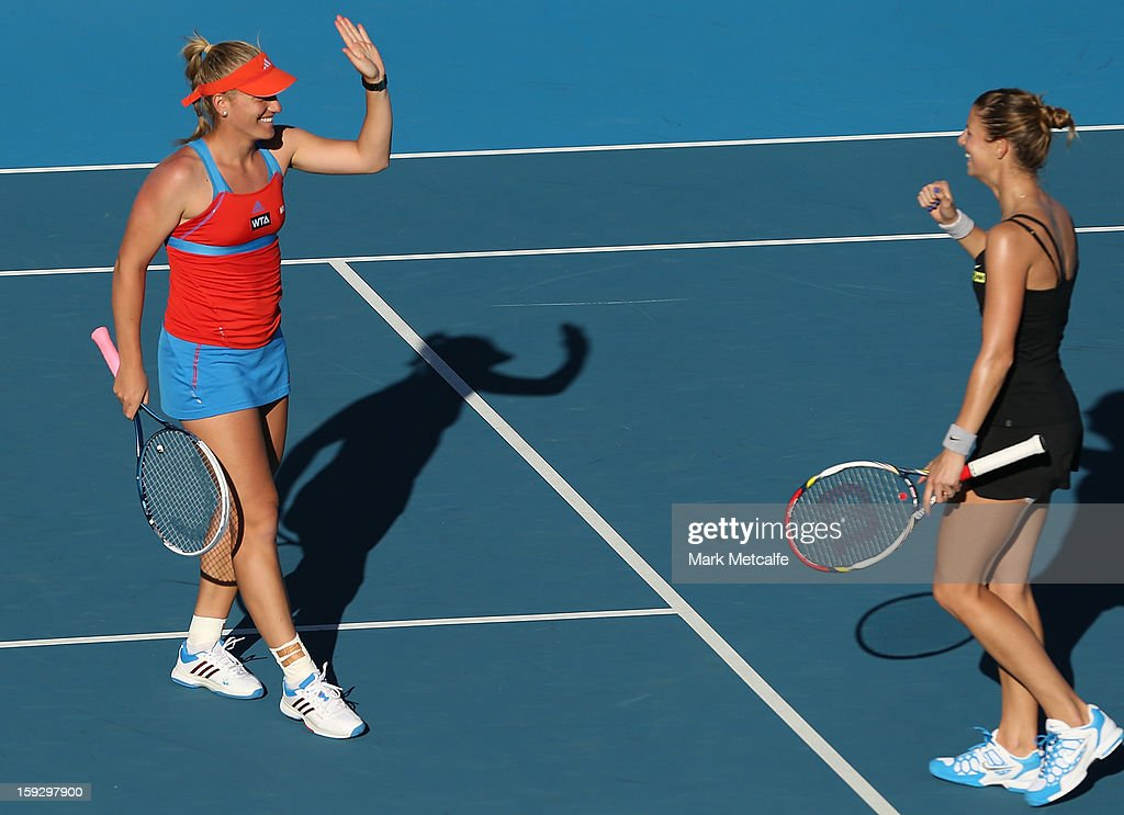 <a gi-track='captionPersonalityLinkClicked' href=/galleries/search?phrase=Timea+Babos&family=editorial&specificpeople=5891501 ng-click='$event.stopPropagation()'>Timea Babos</a> of Hungary and <a gi-track='captionPersonalityLinkClicked' href=/galleries/search?phrase=Mandy+Minella&family=editorial&specificpeople=3378502 ng-click='$event.stopPropagation()'>Mandy Minella</a> of Luxembourg celebrate winning match point in their doubles semi final match against Lara Arruabarrena-Vecino and Lourdes Dominguez Lino of Spain during day eight of the Hobart International at Domain Tennis Centre on January 11, 2013 in Hobart, Australia.