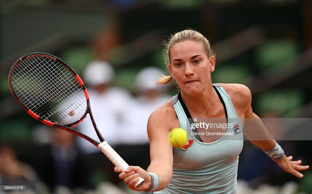 Timea Babos of Hungary hits a forehand during the Ladies Singles second round match against Kristina Mladenovic of France on day five of the 2016 French Open at Roland Garros on May 26, 2016 in Paris, France.