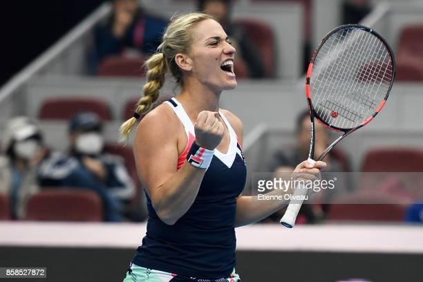 Timea Babos of Hungary partner of Andrea Hlavackova of the Czech Republic celebrates their victory over Ekaterina Makarova and Elena Vesnina of...