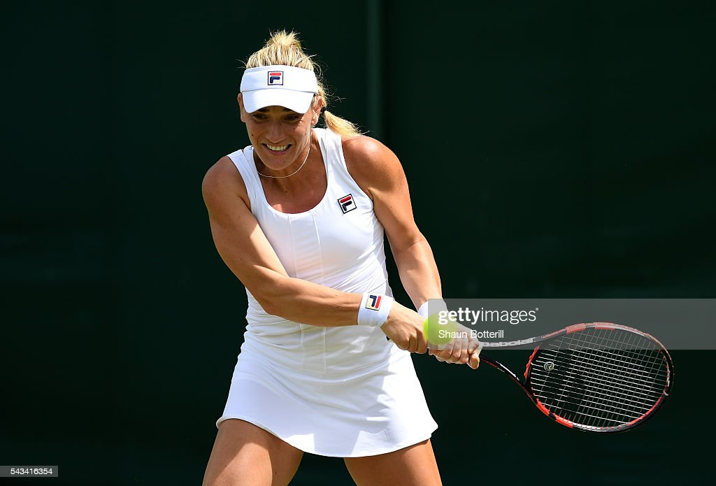 <a gi-track='captionPersonalityLinkClicked' href=/galleries/search?phrase=Timea+Babos&family=editorial&specificpeople=5891501 ng-click='$event.stopPropagation()'>Timea Babos</a> of Hungary plays a backhand during the LadiesSingles first round match against Katie Swan of Great Britain on day two of the Wimbledon Lawn Tennis Championships at the All England Lawn Tennis and Croquet Club on June 28, 2016 in London, England.