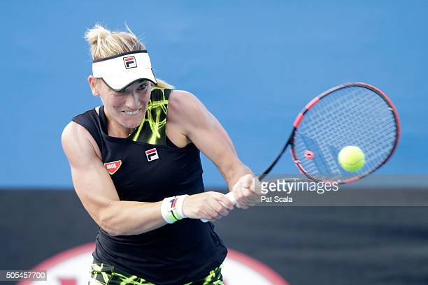 Timea Babos of Hungary plays a backhand in her first round match against Heather Watson of Great Britain during day one of the 2016 Australian Open...