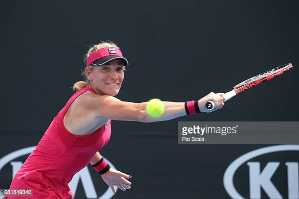 Timea Babos of Hungary plays a backhand in her first round match against Nicole Gibbs of the United States on day two of the 2017 Australian Open at...