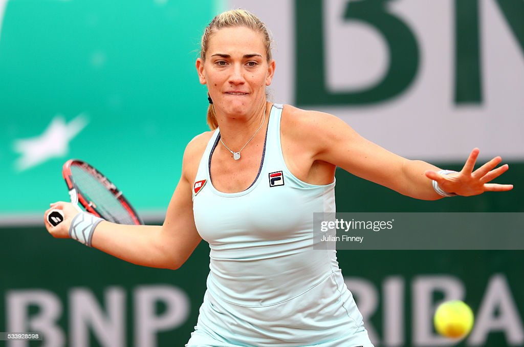 <a gi-track='captionPersonalityLinkClicked' href=/galleries/search?phrase=Timea+Babos&family=editorial&specificpeople=5891501 ng-click='$event.stopPropagation()'>Timea Babos</a> of Hungary plays a forehand during the Women's Singles first round match against Samantha Crawford of the United States on day three of the 2016 French Open at Roland Garros on May 24, 2016 in Paris, France.