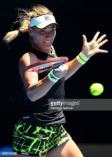 Timea Babos of Hungary plays a forehand in her second round match against Belinda Bencic of Switzerland during day three of the 2016 Australian Open...