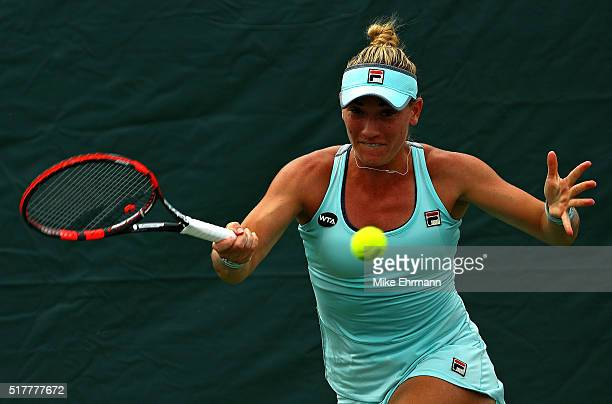 Timea Babos of Hungary plays a match against Naomi Osaka of Japan during Day 7 of the Miami Open presented by Itau at Crandon Park Tennis Center on...
