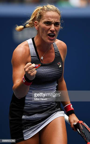Timea Babos of Hungary reacts against Simona Halep of Romania during her third round Women's Singles match on Day Six of the 2016 US Open at the USTA...