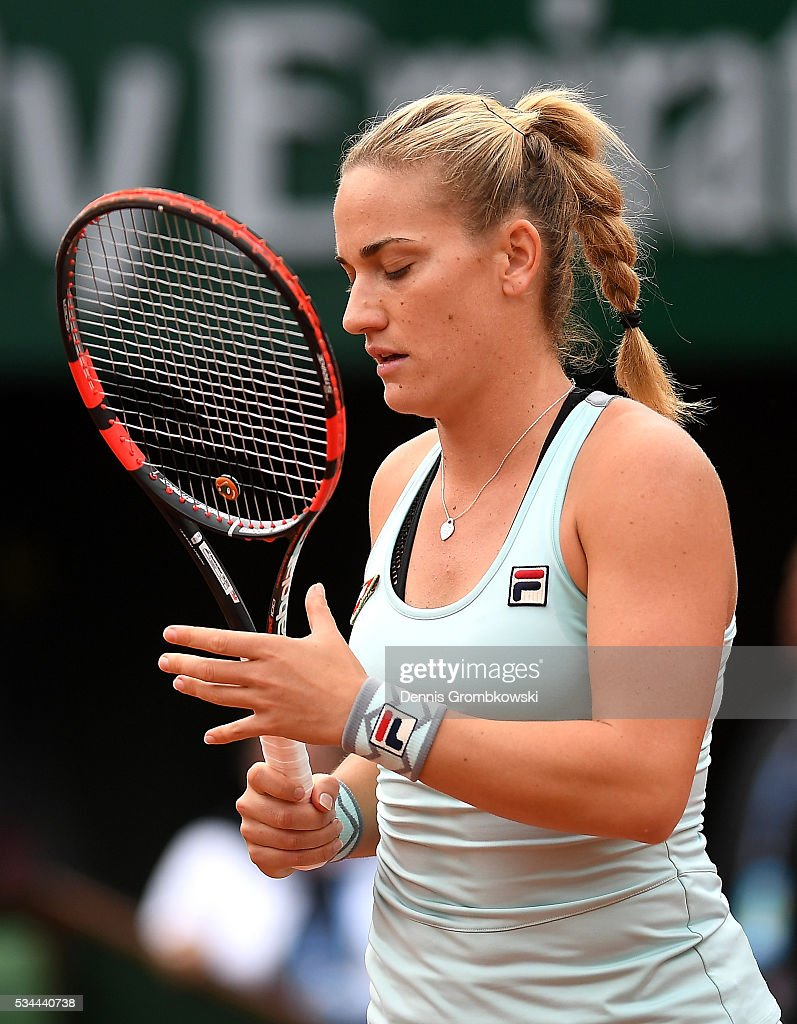 Timea Babos of Hungary reacts during the Ladies Singles second round match against <a gi-track='captionPersonalityLinkClicked' href=/galleries/search?phrase=Kristina+Mladenovic&family=editorial&specificpeople=4835181 ng-click='$event.stopPropagation()'>Kristina Mladenovic</a> of France on day five of the 2016 French Open at Roland Garros on May 26, 2016 in Paris, France.