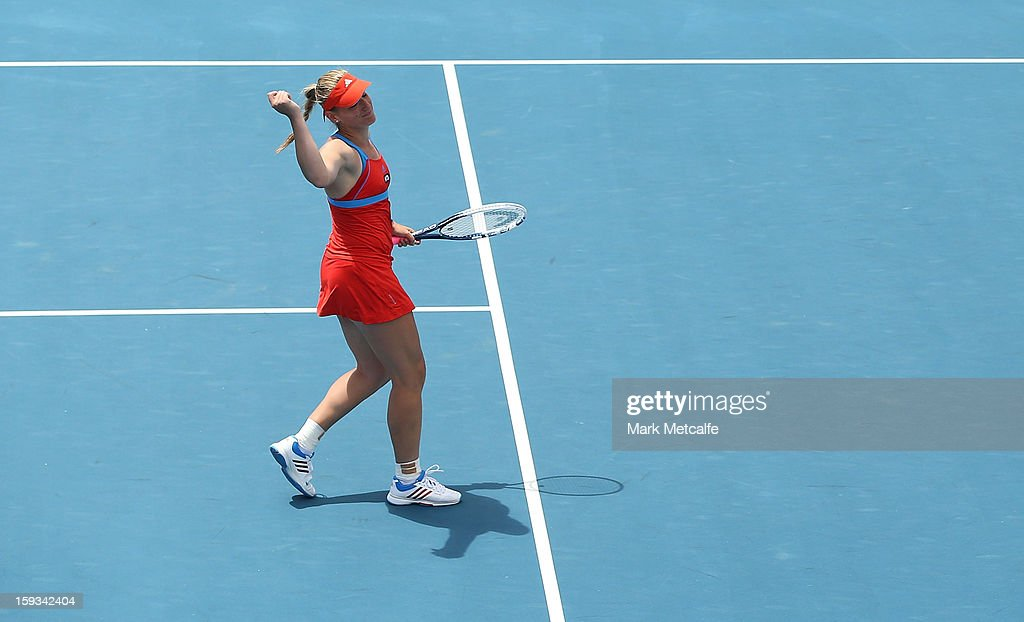 Timea Babos of Hungary reacts to losing a point whilst partnering Mandy Minella of Luxembourg in their doubles final match against Garbine Muguruza and Maria-Teresa Torro-Flor of Spain during day nine of the Hobart International at Domain Tennis Centre on January 12, 2013 in Hobart, Australia.