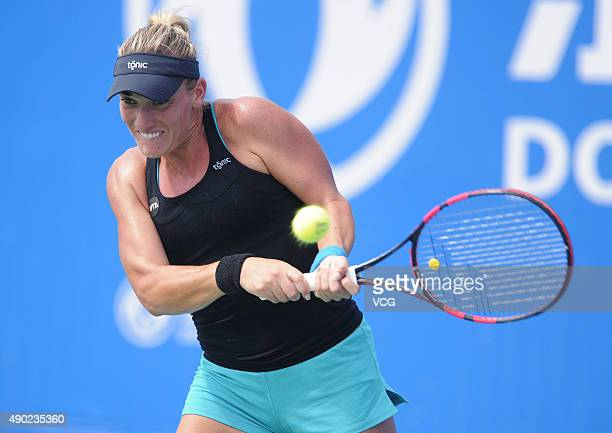 Timea Babos of Hungary returns a shot against Barbora Strycova of Czech Republic during a match in the first round of 2015 Wuhan Open at Optics Vally...