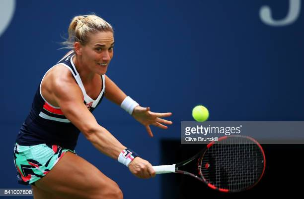 Timea Babos of Hungary returns a shot against Maria Sharapova of Russia during their second round Women's Singles match on Day Three of the 2017 US...