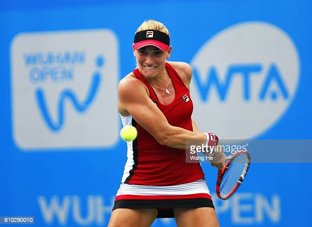 Timea Babos of Hungary returns a shot during the match against Katerina Siniakova of Czech Republic on Day 1 of 2016 Dongfeng Motor Wuhan Open at...