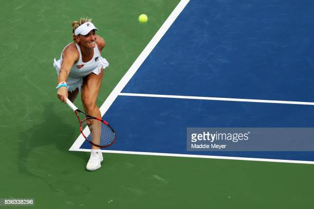 Timea Babos of Hungary returns a shot to Kristina Mladenovic of France during Day 4 of the Connecticut Open at Connecticut Tennis Center at Yale on...