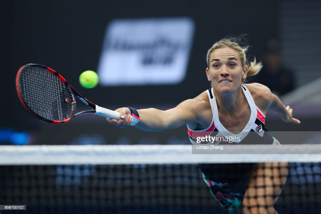 Timea Babos of Hungary returns a shot with Andrea Hlavackova of the Czech Republic against Ekaterina Makarova and Elena Vesnina of Russia during their Women's doubles semifinal match on day eight of the 2017 China Open at the China National Tennis Centre on October 7, 2017 in Beijing, China.