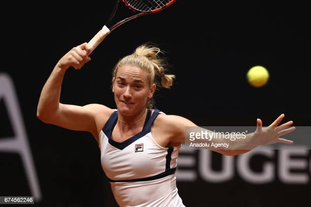 Timea Babos of Hungary returns the ball during the TEB BNP Paribas Istanbul Cup Women's Couple tennis match between Cagla Buyukakcay of Turkey Timea...