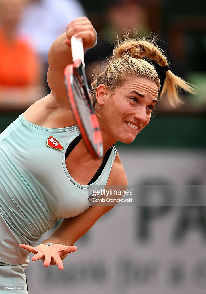Timea Babos of Hungary serves during the Ladies Singles second round match against <a gi-track='captionPersonalityLinkClicked' href=/galleries/search?phrase=Kristina+Mladenovic&family=editorial&specificpeople=4835181 ng-click='$event.stopPropagation()'>Kristina Mladenovic</a> of France on day five of the 2016 French Open at Roland Garros on May 26, 2016 in Paris, France.