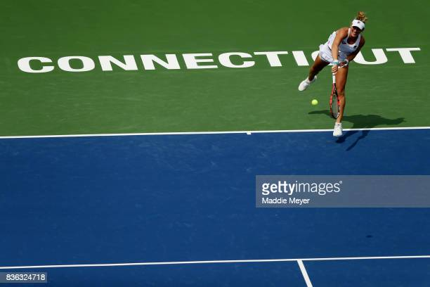 Timea Babos of Hungary serves to Kristina Mladenovic of France during Day 4 of the Connecticut Open at Connecticut Tennis Center at Yale on August 21...