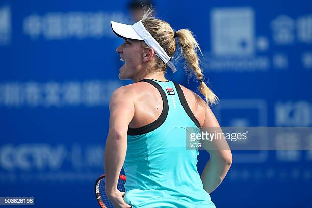 Timea Babos of Hungary shouts against Eugenie Bouchard of Canada in quarter finals match during Day five of 2016 WTA Shenzhen Open at Longgang Sports...