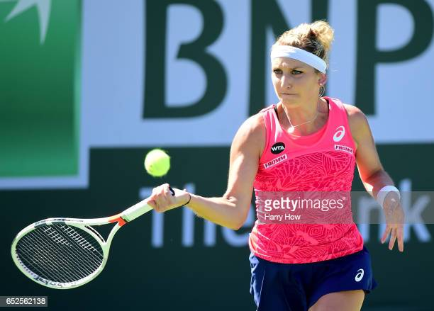 Timea Bacsinsky of Switzerland hits a forehand in her match against Kiki Bertens of the Netherlands during the BNP Paribas Open at Indian Wells...