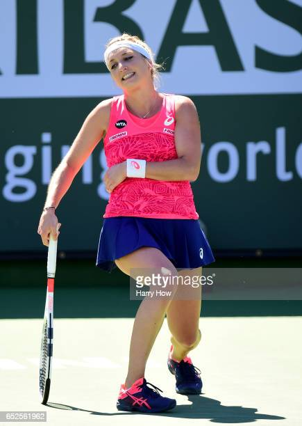 Timea Bacsinsky of Switzerland reacts as she loses a point in her match against Kiki Bertens of the Netherlands during the BNP Paribas Open at Indian...