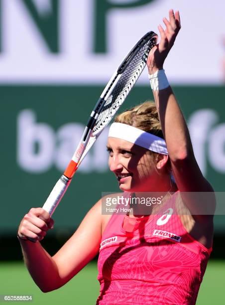 Timea Bacsinsky of Switzerland reacts to her win over Kiki Bertens of the Netherlands during the BNP Paribas Open at Indian Wells Tennis Garden on...