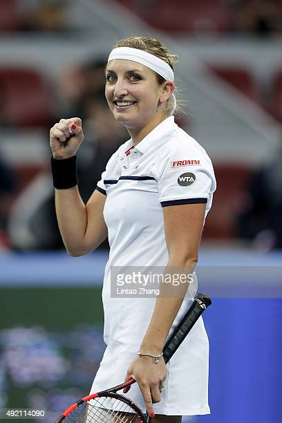 Timea Bacsinszky of Switzerland celebrates after winning her match against Ana Ivanovic of Serbia during the Women's singles semifinals match on day...