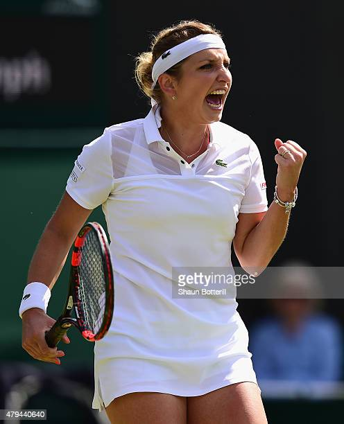 Timea Bacsinszky of Switzerland celebrates in her Ladies' Singles Third Round match against Sabine Lisicki of Germany during day six of the Wimbledon...