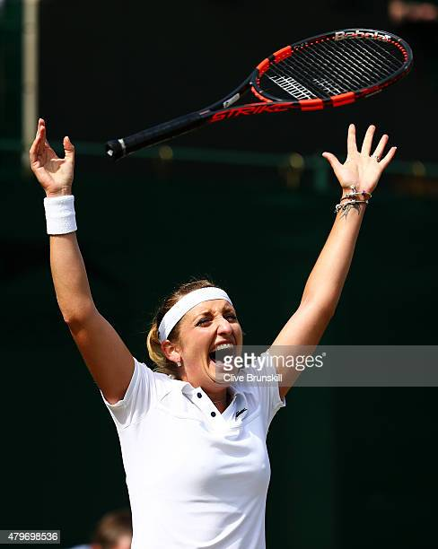 Timea Bacsinszky of Switzerland celebrates match point in her Ladies' Singles Fourth Round match against Monica Niculescu of Romania during day seven...