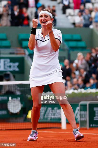 Timea Bacsinszky of Switzerland celebrates match point in her Women's Singles match against Petra Kvitova of Czech Republic on day nine of the 2015...