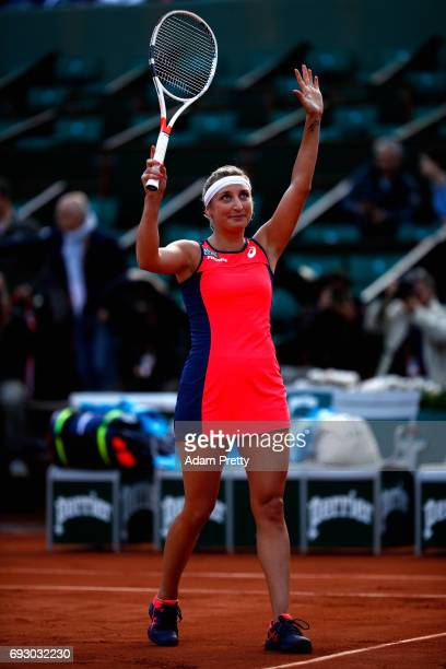Timea Bacsinszky of Switzerland celebrates victory during ladies singles Quarter Finals match against Kristina Mladenovic of France on day ten of the...