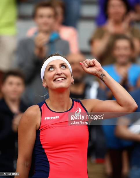 Timea Bacsinszky of Switzerland celebrates victory following the ladies singles third round match against Ons Jabeur of Tunisia on day six of the...