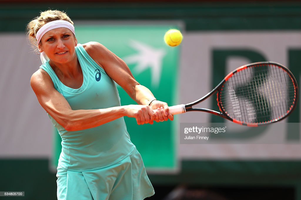 <a gi-track='captionPersonalityLinkClicked' href=/galleries/search?phrase=Timea+Bacsinszky&family=editorial&specificpeople=675184 ng-click='$event.stopPropagation()'>Timea Bacsinszky</a> of Switzerland hits a backhand during the Ladies Singles third round match against Pauline Parmentier of France on day seven of the 2016 French Open at Roland Garros on May 28, 2016 in Paris, France.