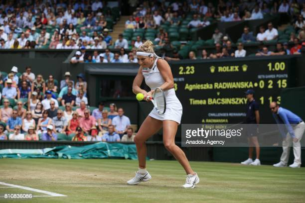 Timea Bacsinszky of Switzerland in action against Agnieszka of Poland on day six of the 2017 Wimbledon Championships at the All England Lawn and...