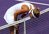 Timea Bacsinszky of Switzerland kisses the net during a semifinal match against Svetlana Kuznetsova of Russia during Day 11 of the Miami Open...