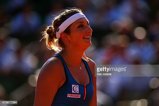 Timea Bacsinszky of Switzerland looks on in her Women's Semi final match against Serena Williams of the United States on day twelve of the 2015...