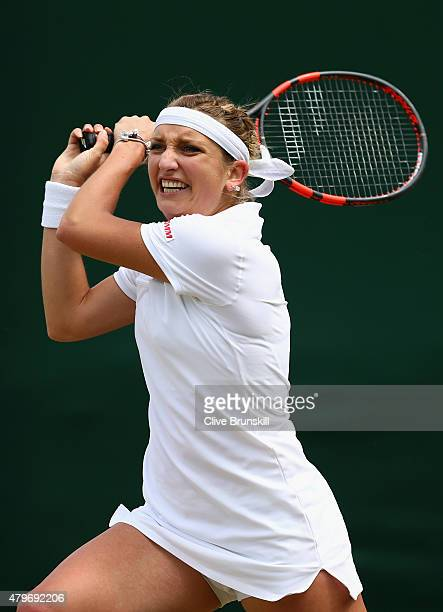 Timea Bacsinszky of Switzerland plays a backhand in her Ladies' Singles Fourth Round match against Monica Niculescu of Romania during day seven of...