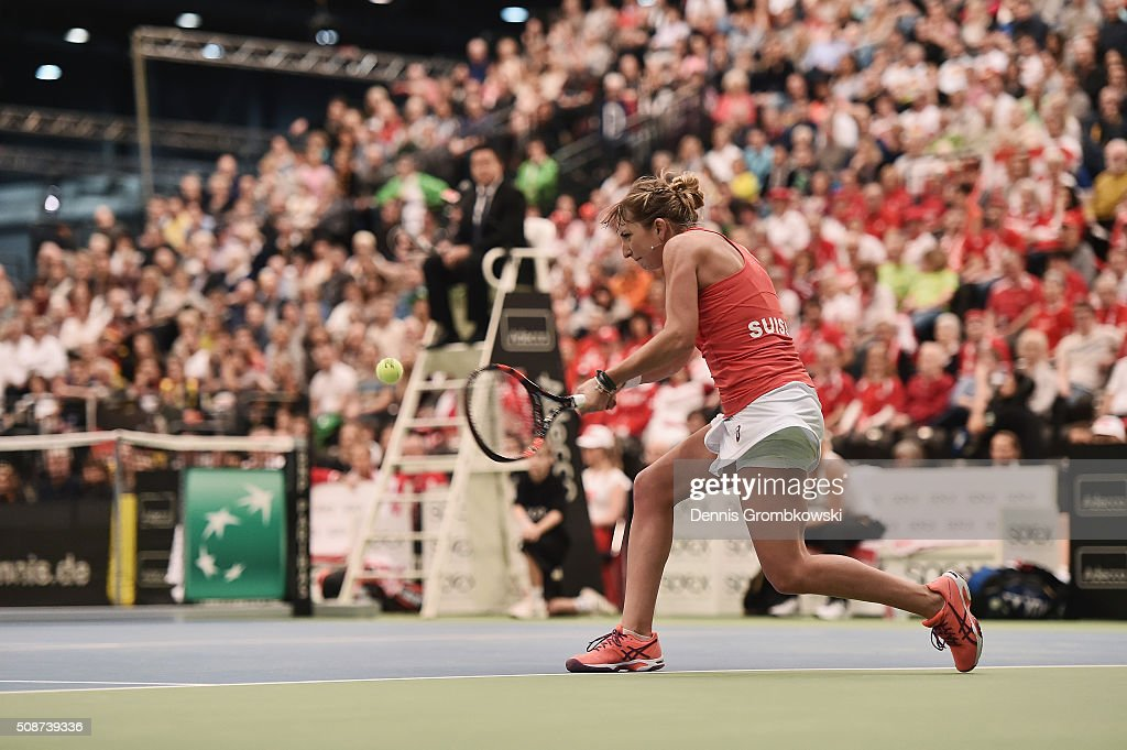 <a gi-track='captionPersonalityLinkClicked' href=/galleries/search?phrase=Timea+Bacsinszky&family=editorial&specificpeople=675184 ng-click='$event.stopPropagation()'>Timea Bacsinszky</a> of Switzerland plays a backhand in her match against Angelique Kerber of Germany during Day 1 of the 2016 Fed Cup World Group First Round match between Germany and Switzerland at Messe Leipzig on February 6, 2016 in Leipzig, Germany.