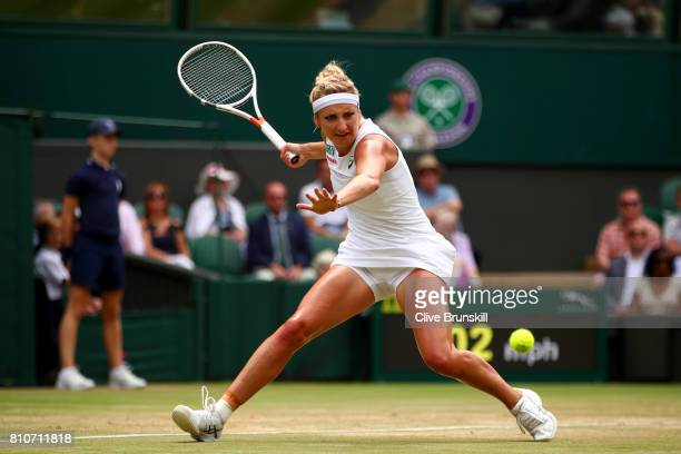 Timea Bacsinszky of Switzerland plays a forehand during the Ladies Singles third round match against Agnieszka Radwanska of Poland on day six of the...