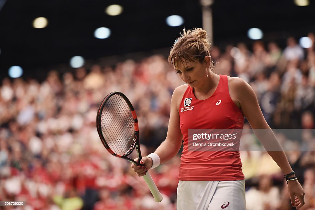 <a gi-track='captionPersonalityLinkClicked' href=/galleries/search?phrase=Timea+Bacsinszky&family=editorial&specificpeople=675184 ng-click='$event.stopPropagation()'>Timea Bacsinszky</a> of Switzerland reacts during her match against Angelique Kerber of Germany during Day 1 of the 2016 Fed Cup World Group First Round match between Germany and Switzerland at Messe Leipzig on February 6, 2016 in Leipzig, Germany.