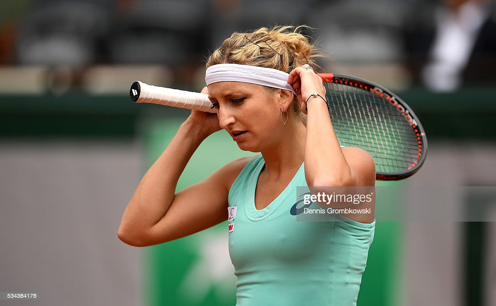 <a gi-track='captionPersonalityLinkClicked' href=/galleries/search?phrase=Timea+Bacsinszky&family=editorial&specificpeople=675184 ng-click='$event.stopPropagation()'>Timea Bacsinszky</a> of Switzerland reacts during the Ladies Singles second round match against Eugenie Bouchard of Canada on day five of the 2016 French Open at Roland Garros on May 26, 2016 in Paris, France.
